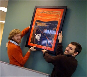 Dan and Spencer hanging our new Molly Art